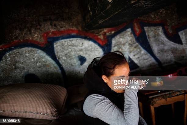 Jessica a homeless heroin addict wipes away tears as she describes how she tested positive for HIV after being raped last year in this spot under the...