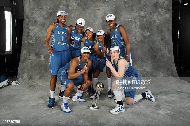 Jessica Adair Amber Harris Monica Wright Maya Moore Candice Wiggins Taj McWilliamsFranklin and Lindsay Whalen of the Minnesota Lynx poses for a...