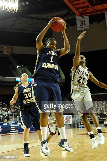 Jessica Adair of George Washington beats Morenike Atunrase of Texas AM for a rebound during CAA Women's Basketball Championship secondround game at...