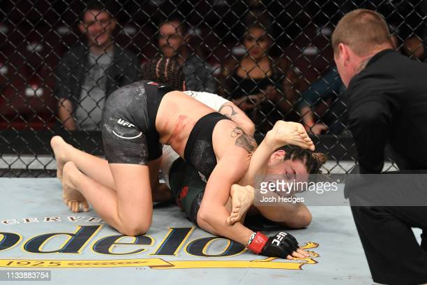 Jessica Aguilar attempts to submit Marina Rodriguez of Brazil in their women's strawweight bout during the UFC Fight Night event at Wells Fargo...