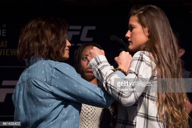 Jessica Aguilar faces off with Cortney Casey during the UFC 211 Ultimate Media Day at the House of Blues Dallas on May 10 2017 in Dallas Texas