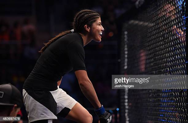 Jessica Aguilar of the United States prepares to enter the Octagon before facing Claudia Gadelha of Brazil in their women's strawweight bout during...