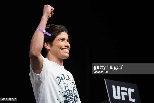 Jessica Aguilar poses on the scale during the UFC 211 weighin at the American Airlines Center on May 12 2017 in Dallas Texas