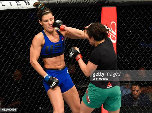 Jessica Aguilar punches Cortney Casey in their women's strawweight fight during the UFC 211 event at the American Airlines Center on May 13 2017 in...