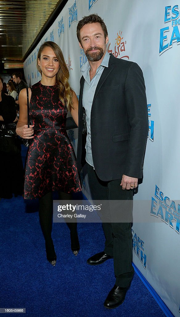 Jessica Alba and Hugh Jackman attend the 'Escape From Planet Earth' premiere presented by The Weinstein Company in partnership with Sabra at Mann Chinese 6 on February 2, 2013 in Los Angeles, California.