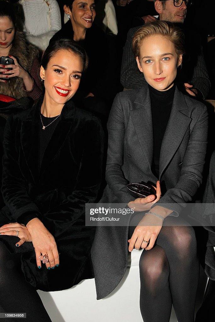 Jessica Alba (L) and Leelee Sobieski attend the Christian Dior Spring/Summer 2013 Haute-Couture show as part of Paris Fashion Week at on January 21, 2013 in Paris, France.
