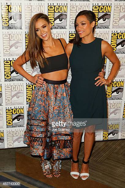 Jessica Alba and Rosario Dawson attend the Sin City A Dame to Kill For press line at ComicCon International 2014 Day 3 on July 26 2014 in San Diego...