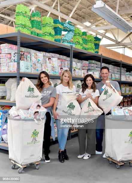 Jessica Alba Kelly Sawyer Patricof Norah Weinstein and Nick Vlahos attend Baby2Baby And The Honest Company Partnership Kick Off Donation on May 4...