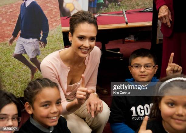 Jessica Alba poses with a group of children during a news conference to discuss the 1Goal campaign at the Rayburn House Office Building on April 21...