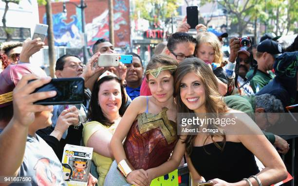 Jessica Altman daughter of Lynda Carter poses with a Wonder Woman at the Star ceremony for Lynda Carter held On The Hollywood Walk Of Fame on April 3...