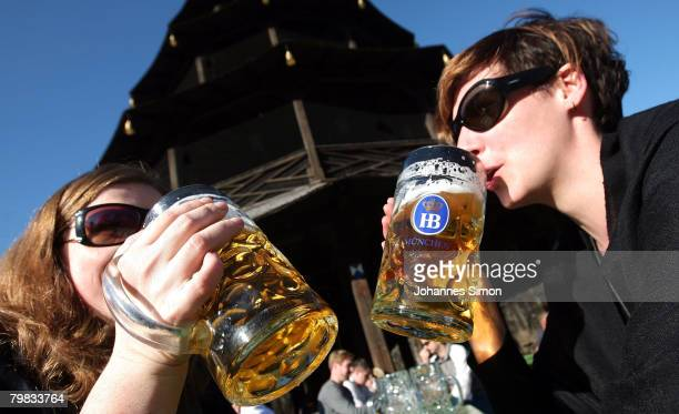 Jessica and Pascale drink beer sitting in the sun in front of Chinesischer Turm in the English Garden on February 19 2008 in Munich Germany Germany...