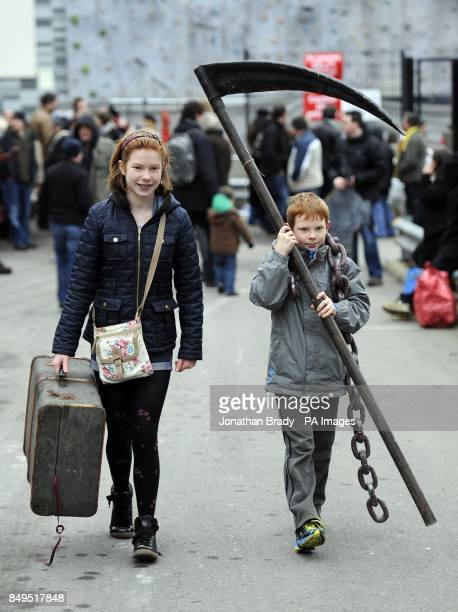 Jessica and Robert Hubery from Buckingham leave with items purchased at the London Dungeon 'Carnage Car Boot Stall' held at the Capital Car Boot Sale...