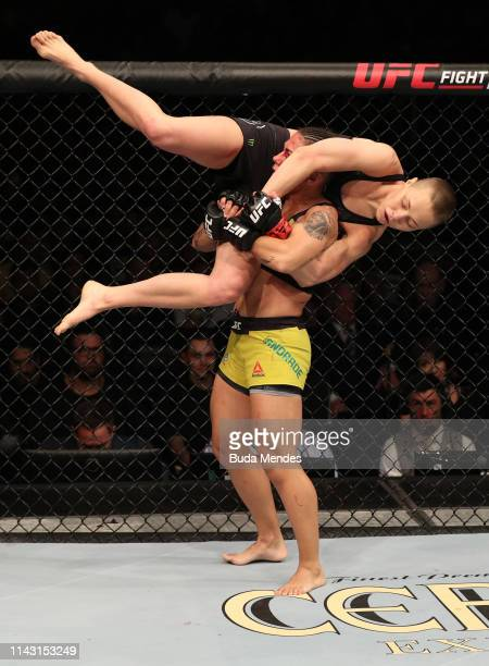 Jessica Andrade of Brazil attempts to slam Rose Namajunas in their women's strawweight championship bout during the UFC 237 event at Jeunesse Arena...