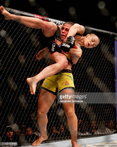 Jessica Andrade of Brazil attempts to slam Rose Namajunas of USA in their women's strawweight championship bout during the UFC 237 event at Jeunesse...