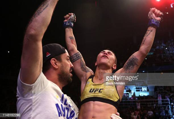 Jessica Andrade of Brazil celebrates after her knockout victory over Rose Namajunas in their women's strawweight championship bout during the UFC 237...