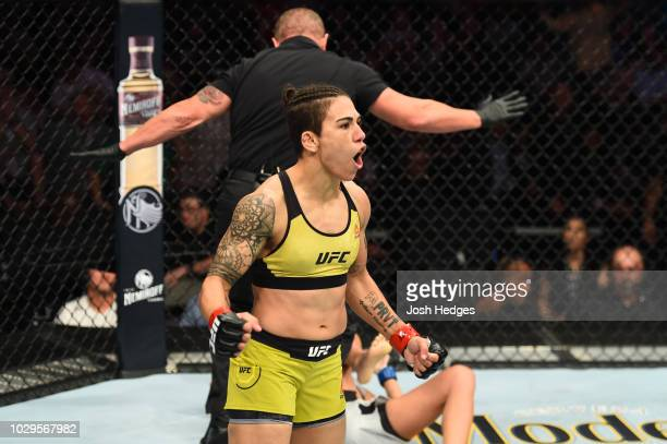 Jessica Andrade of Brazil celebrates after knocking out Karolina Kowalkiewicz of Poland in their women's strawweight fight during the UFC 228 event...
