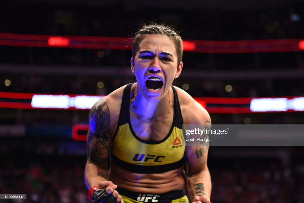 Jessica Andrade of Brazil celebrates after knocking out Karolina Kowalkiewicz of Poland in their women's strawweight fight during the UFC 228 event at American Airlines Center on September 8, 2018 in Dallas, Texas.