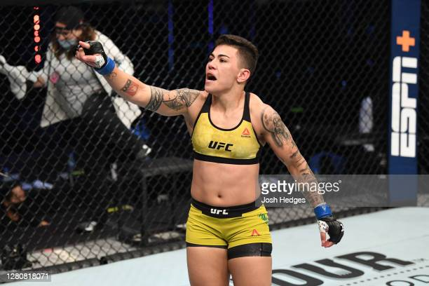 Jessica Andrade of Brazil celebrates her TKO victory over Katlyn Chookagian in their women's flyweight bout during the UFC Fight Night event inside...