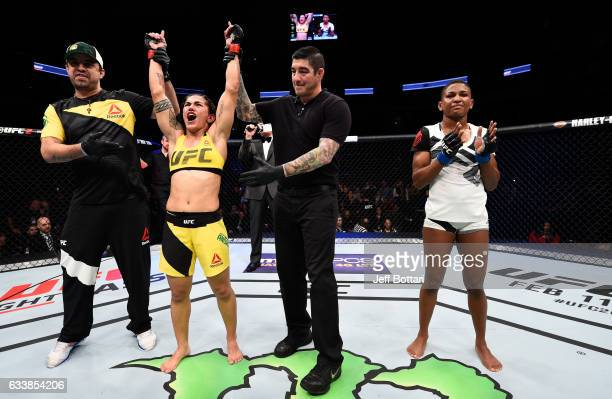Jessica Andrade of Brazil celebrates her victory over Angela Hill in their women's strawweight bout during the UFC Fight Night event at the Toyota...