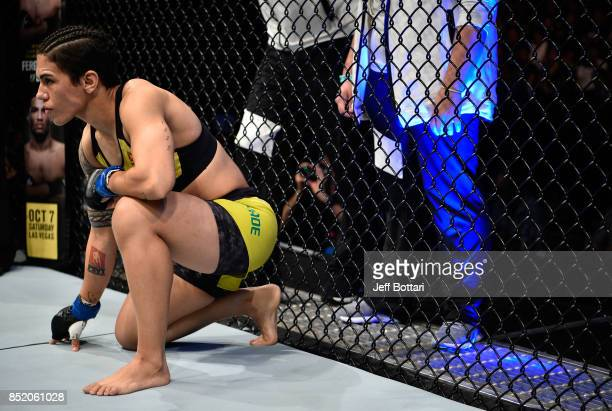 Jessica Andrade of Brazil enters the Octagon before facing Claudia Gadelha of Brazil in their women's strawweight bout during the UFC Fight Night...