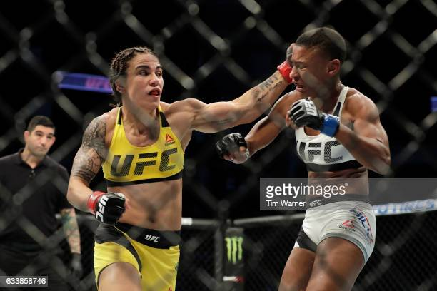 Jessica Andrade of Brazil hits Angela Hill with a left hook during their women's strawweight bout at UFC Fight Night at the Toyota Center on February...
