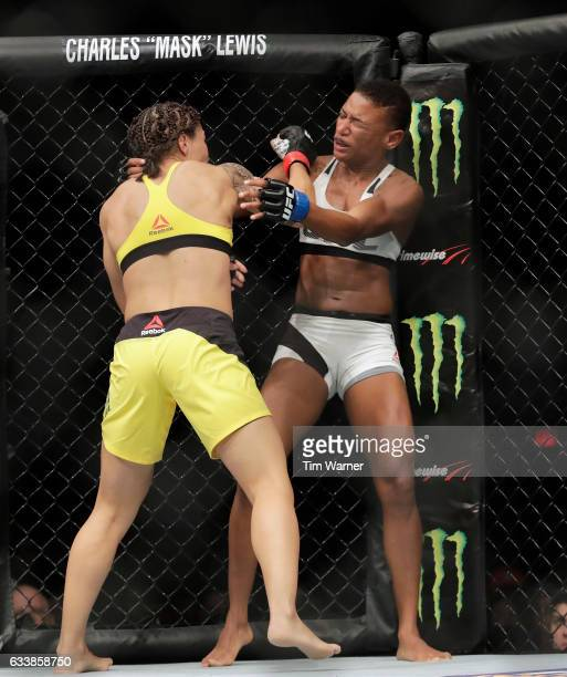 Jessica Andrade of Brazil hits Angela Hill with a right hand during their women's strawweight bout at UFC Fight Night at the Toyota Center on...