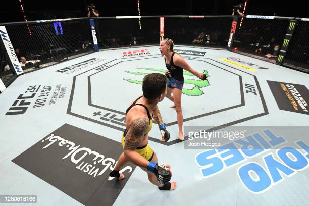 Jessica Andrade of Brazil hurts the body of Katlyn Chookagian in their women's flyweight bout during the UFC Fight Night event inside Flash Forum on...