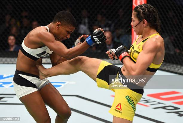 Jessica Andrade of Brazil kicks Angela Hill in their women's strawweight bout during the UFC Fight Night event at the Toyota Center on February 4...