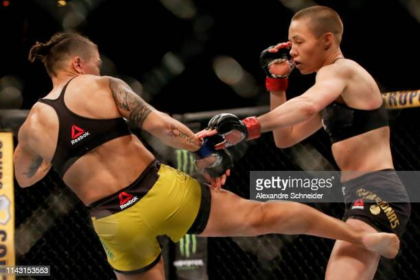 Jessica Andrade of Brazil kicks Rose Namajunas of USA in their women's strawweight championship bout during the UFC 237 event at Jeunesse Arena on...