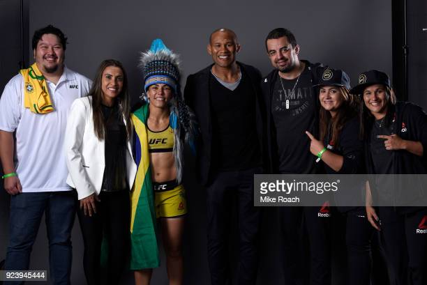 Jessica Andrade of Brazil poses for a portrait backstage with her team and family after her victory over Tecia Torres during the UFC Fight Night...