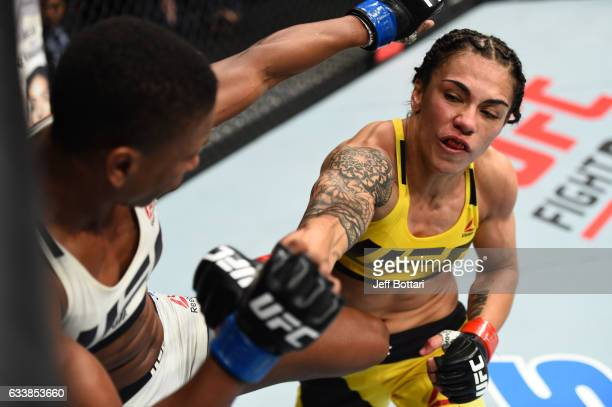 Jessica Andrade of Brazil punches Angela Hill in their women's strawweight bout during the UFC Fight Night event at the Toyota Center on February 4...
