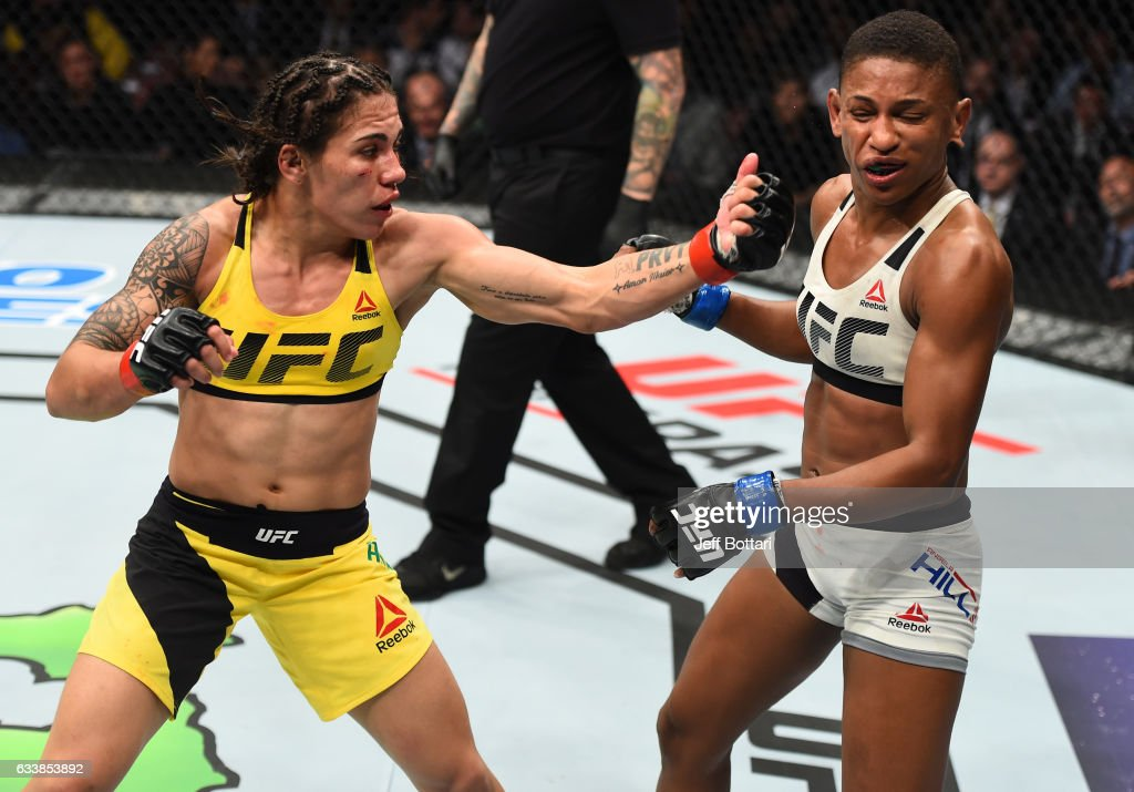 Jessica Andrade of Brazil punches Angela Hill in their women's strawweight bout during the UFC Fight Night event at the Toyota Center on February 4, 2017 in Houston, Texas.