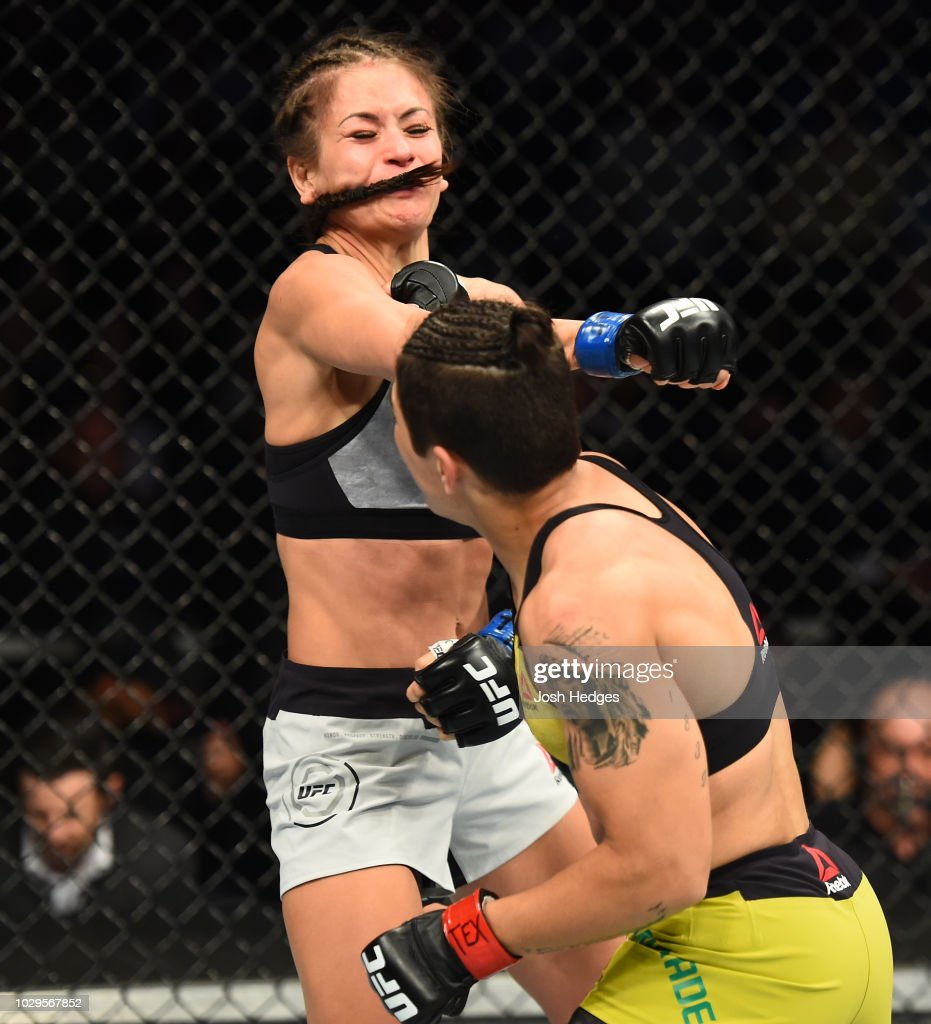 Jessica Andrade of Brazil punches Karolina Kowalkiewicz of Poland in their women's strawweight fight during the UFC 228 event at American Airlines Center on September 8, 2018 in Dallas, Texas.