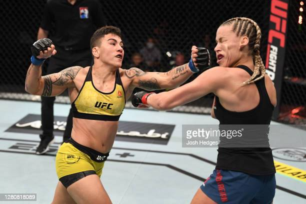 Jessica Andrade of Brazil punches Katlyn Chookagian in their women's flyweight bout during the UFC Fight Night event inside Flash Forum on UFC Fight...