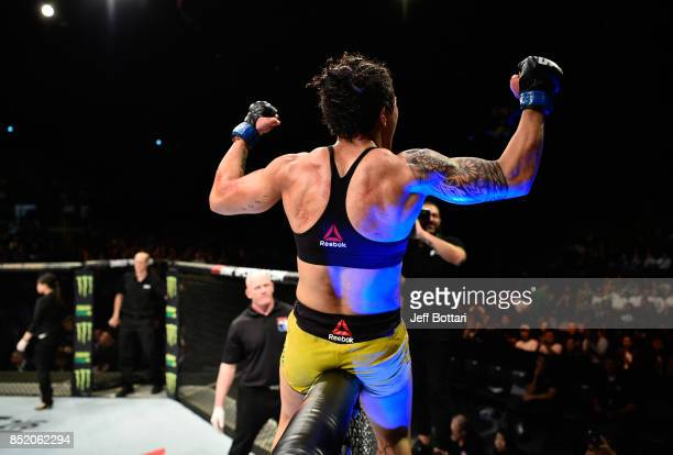 Jessica Andrade of Brazil raises her hands after facing Claudia Gadelha of Brazil in their women's strawweight bout during the UFC Fight Night event...