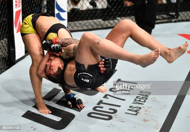 Jessica Andrade of Brazil takes down Claudia Gadelha of Brazil in their women's strawweight bout during the UFC Fight Night event inside the Saitama...