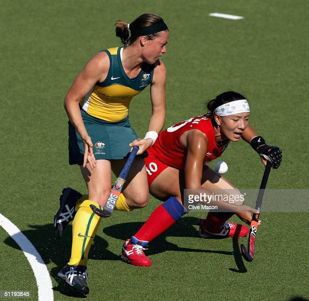 Jessica Arrold of Australia challenges Ko Woon Oh of Korea in the women's field hockey preliminaries on August 20 2004 during the Athens 2004 Summer...