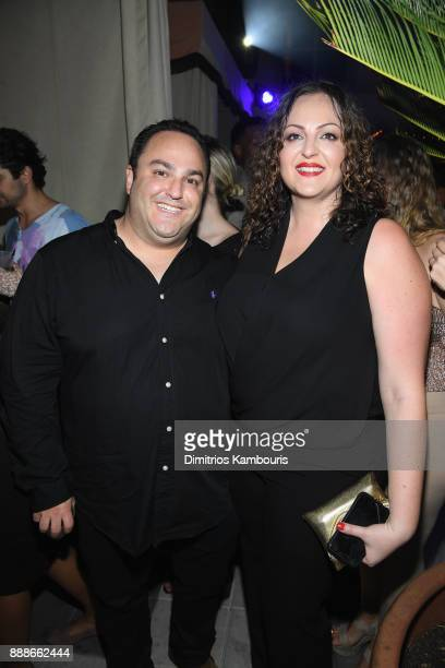 Jessica Athanasiou and guest attend the Maxim December Miami Issue Party Presented by blu on December 8 2017 in Miami Beach Florida