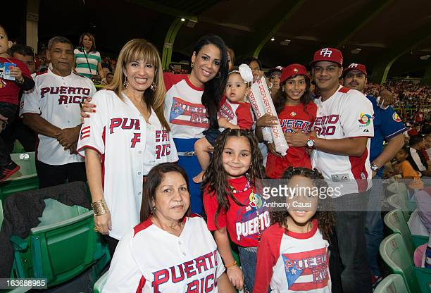 Jessica Beltran the wife of Carlos Beltran of Team Puerto Rico is seen in the stands with members of the family during Pool C Game 2 between Spain...