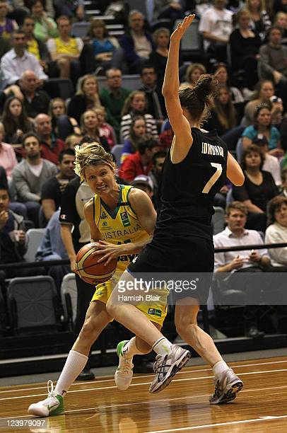 Jessica Bibby of Australia contests with Antonia Edmondson of New Zealand during the first match between the Australian Opals and the New Zealand...