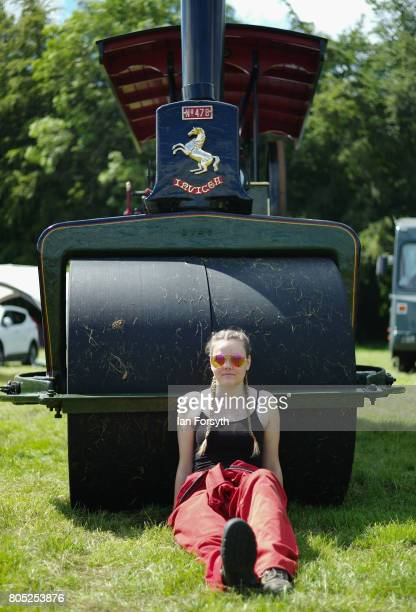 Jessica Bone from Great Ayton sits against the wheel of a steam engine as she helps to clean it during the Duncombe Park Steam Rally on July 1 2017...