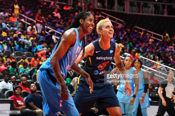Jessica Breland of Atlanta Dream and Candice Dupree of the Indiana Fever smile during a game on June 19, 2019 at the State Farm Arena in Atlanta,...