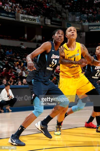 Jessica Breland of the Atlanta Dream boxes out Candice Dupree of the Indiana Fever on June 16 2018 at Bankers Life Fieldhouse in Indianapolis Indiana...