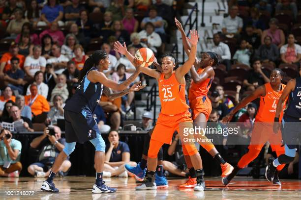 Jessica Breland of the Atlanta Dream passes the ball against around Alyssa Thomas of the Connecticut Sun on JULY 17 2018 at the Mohegan Sun Arena in...