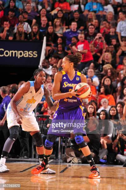 Jessica Breland of the Eastern Conference AllStars defends against Candace Parker of the Western Conference AllStars during the 2014 Boost Mobile...