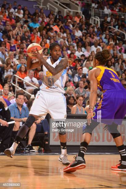 Jessica Breland of the Eastern Conference AllStars drives against Candace Parker of the Western Conference AllStars during the 2014 Boost Mobile WNBA...