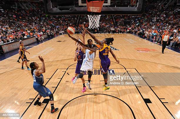 Jessica Breland of the Eastern Conference AllStars shoots against Nneka Ogwumike of the Western Conference AllStars during the 2014 Boost Mobile WNBA...