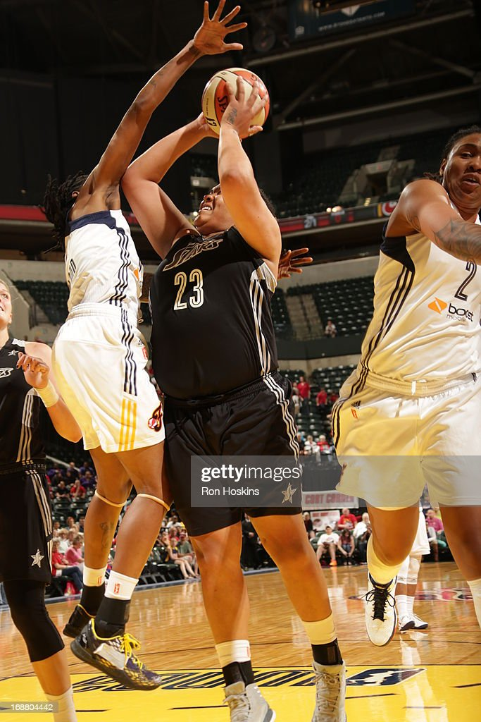 Jessica Breland #51 of the Indiana Fever defends Danielle Adams #32 of the San Antonio Silver Stars on May 13, 2013 at Bankers Life Fieldhouse in Indianapolis, Indiana.