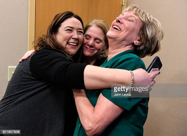 Jessica Brennan Kim Callinan and Barbara Coombs share a hug after finding out that Prop 106 has passed which would allow terminally ill patients to...