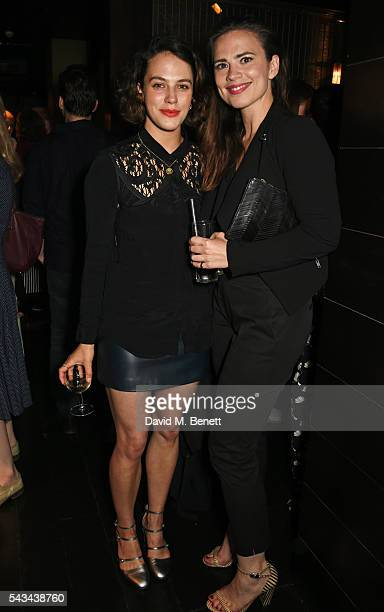 Jessica Brown Findlay and Hayley Atwell attend the press night after party for '1984' at The Mint Leaf on June 28 2016 in London England